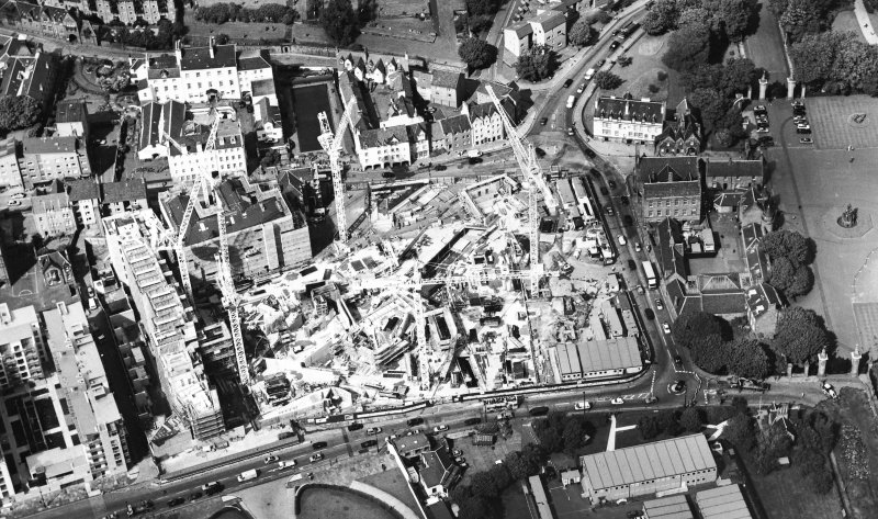 Oblique aerial view centred on the construction of the Scottish Parliament, taken from the SSE.