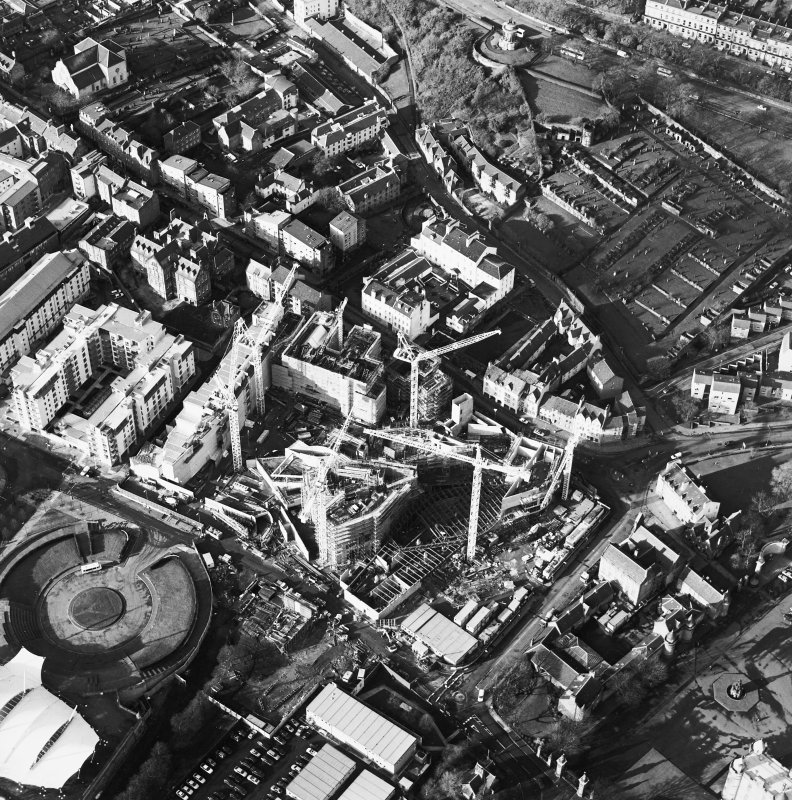 Oblique aerial view centred on the construction of the Scottish Parliament with `Our Dynamic Earth and Queensberry House adjacent, taken from the ESE.