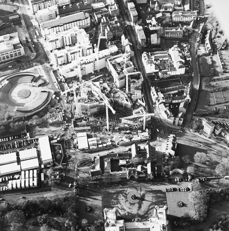 Oblique aerial view centred on the construction of the Scottish Parliament with `Our Dynamic Earth and Queensberry House adjacent, taken from the ENE.