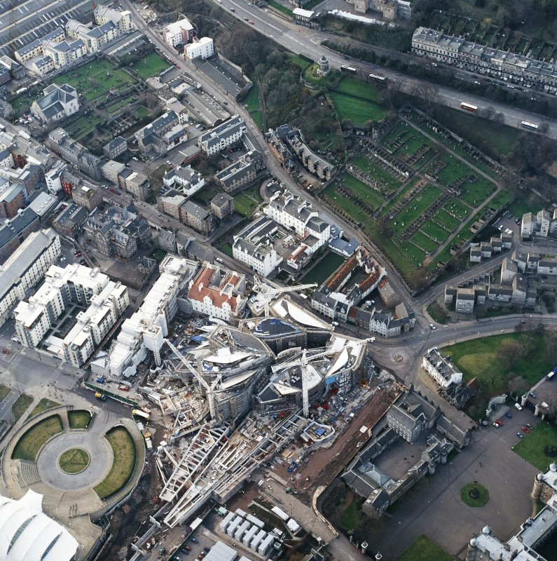 Oblique aerial view centred on the construction of the Scottish Parliament with exhibition centre adjacent, taken from the SSW.