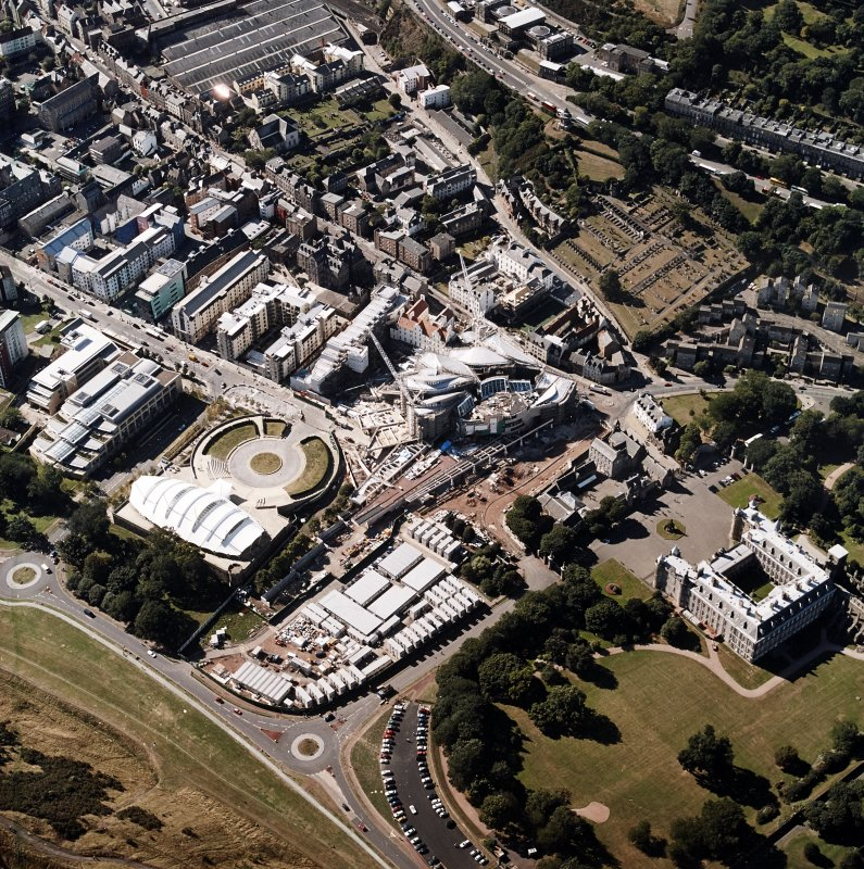 Oblique aerial view centred on the construction of the Scottish Parliament with the exhibition centre and palace adjacent, taken from the ESE.
