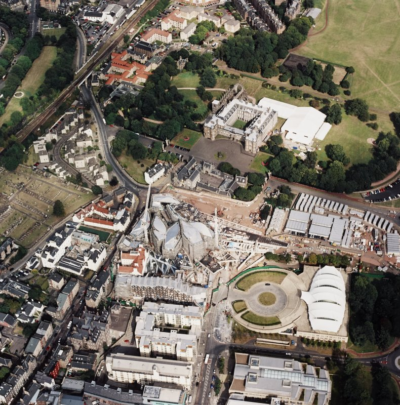 Oblique aerial view centred on the construction of the Scottish Parliament with Our Dynamic Earth, Queensbury House and Holyrood Palace adjacent, taken from the WSW.