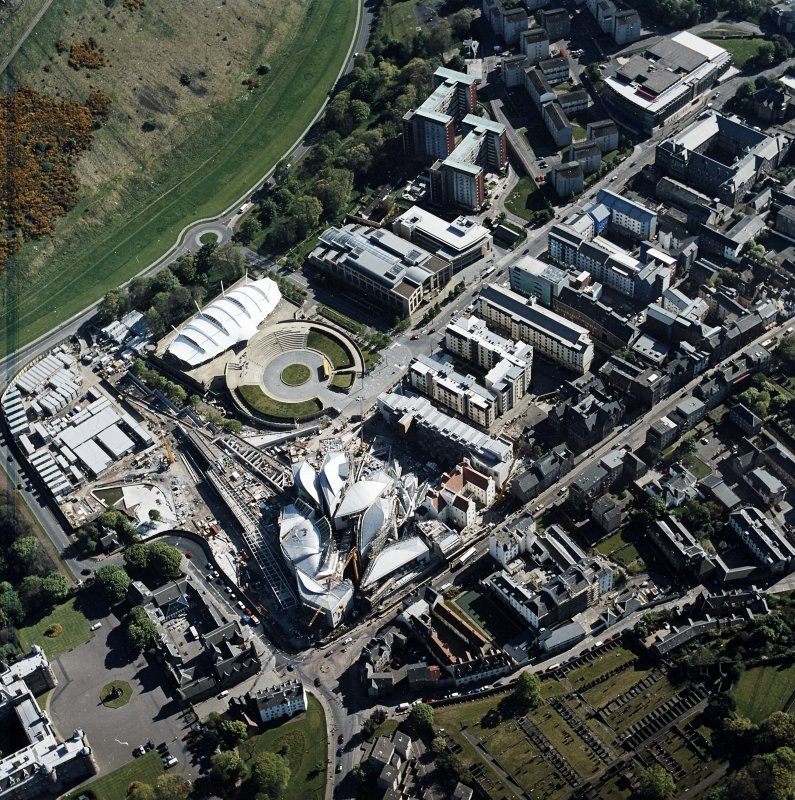 Oblique aerial view centred on the construction of the Scottish Parliament with the exhibition centre and palace adjacent, taken from the N.