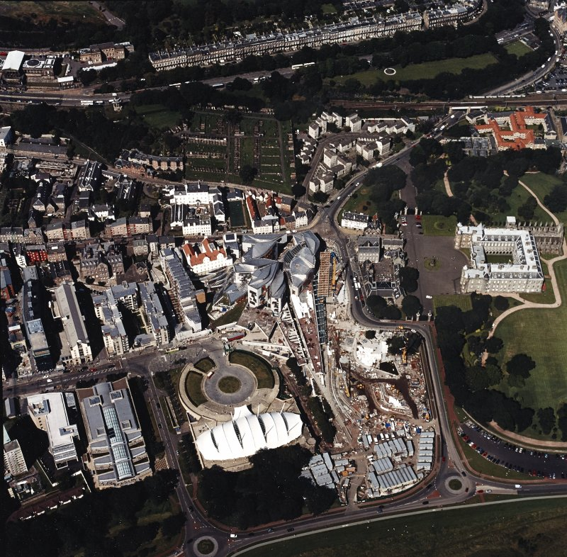 Oblique aerial view centred on the Scottish parliament building with `Our Dynamic Earth¿ and Holyrood palace adjacent, taken from the SSE.