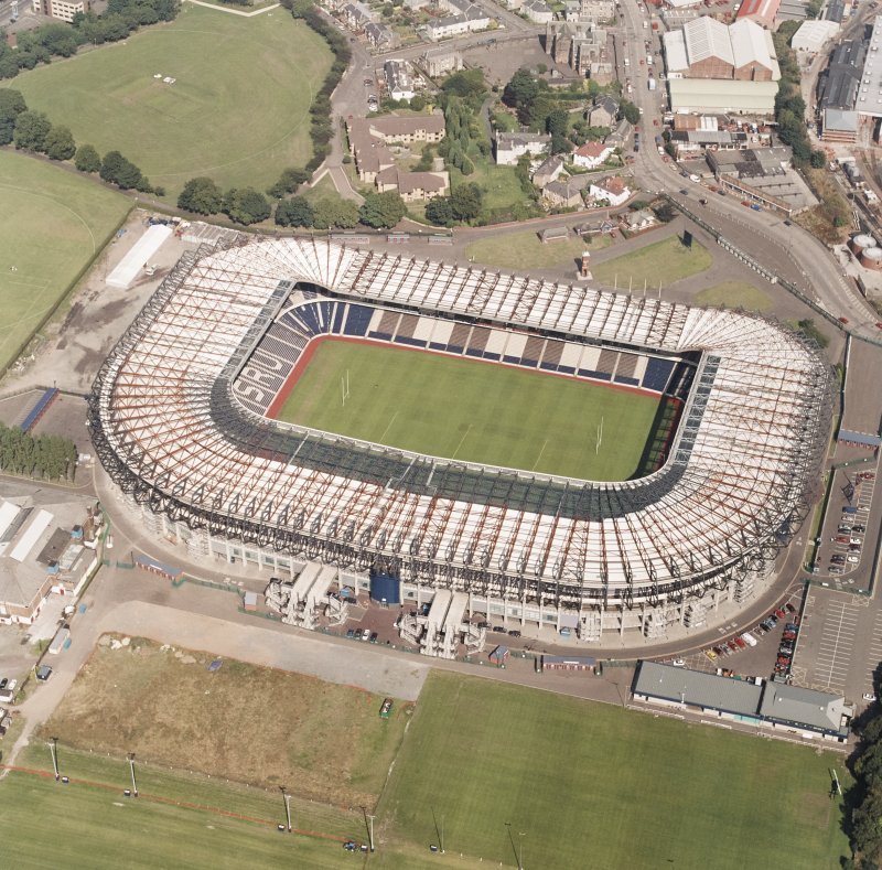 Edinburgh, Murrayfield Stadium, oblique aerial view, taken from the SW, centred on Murrayfield Stadium. Roseburn House is visible in the top centre half of the photograph.