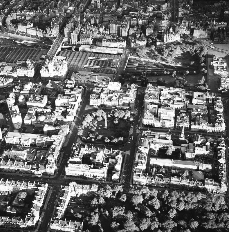 Edinburgh, oblique aerial view taken from the NW, centred on on Melville's Monument in St Andrews Square and Waverley Station