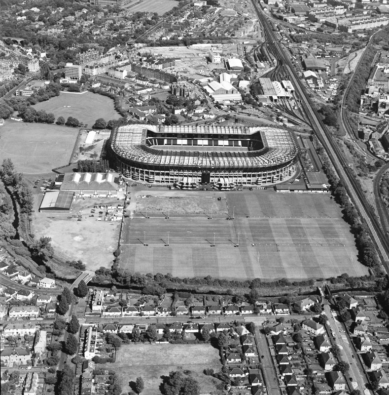 Edinburgh, Murrayfield Stadium, oblique aerial view, taken from the WSW, centred on Murrayfield Stadium. Murrayfield Ice Rink and Roseburn House are visible in the centre of the photograph.