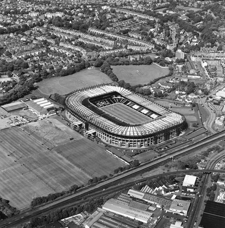 Edinburgh, Murrayfield Stadium, oblique aerial view, taken from the SSW, centred on Murrayfield Stadium. Murrayfield Ice Rink and Roseburn House are visible in the centre of the photograph.
