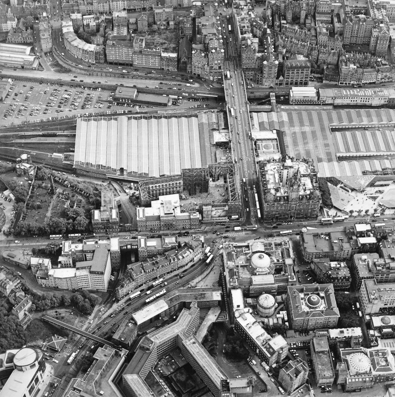 Oblique aerial view centred on the redevelopment of the former post office, with the register house under repair and the railway station and hotel adjacent, taken from the NNW.