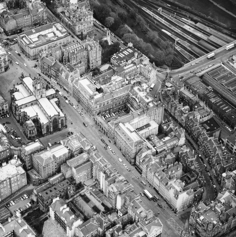 Aerial view showing High Street between North Bridge and Lawnmarket, with St Giles' Cathedral on left and City Chambers on right.