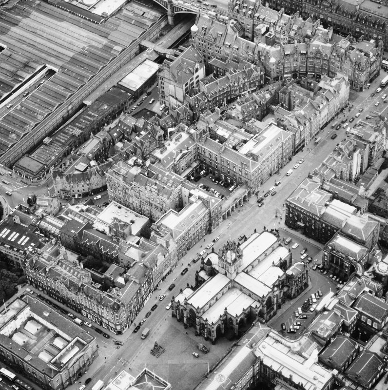 Aerial view showing High Street between North Bridge and Lawnmarket with St Giles' Cathedral on right and City Chambers on left