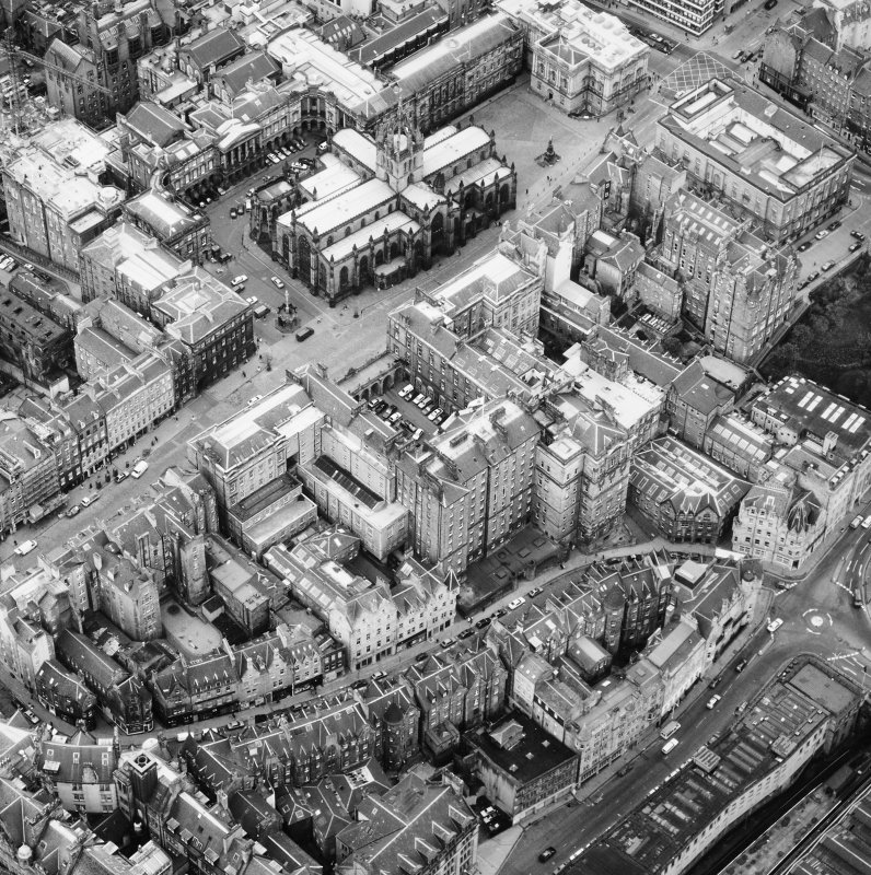 Aerial view showing High Street between North Bridge and Lawnmarket with Cockburn Street at bottom of photo, City Chambers in centre and St Giles' Cathedral at top