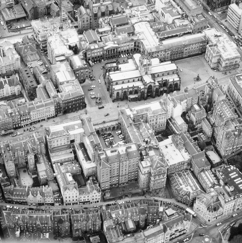 Aerial view showing High Street between North Bridge and Lawnmarket with Cockburn Street at bottom of photo, City Chambers in centre and St Giles' Cathedral at top.