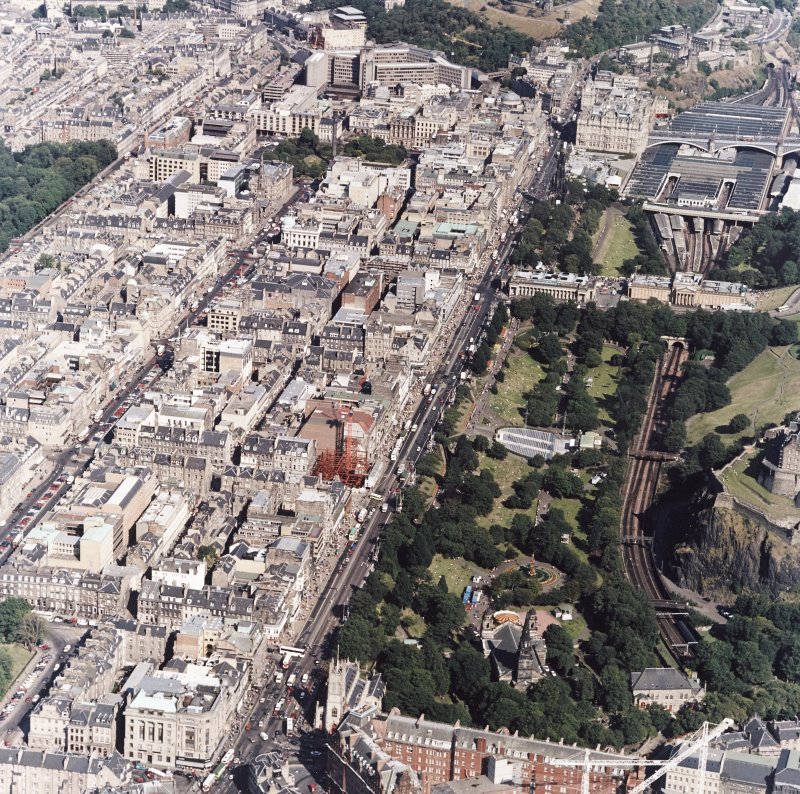 Oblique aerial view, taken from the WSW, showing the New Town on the left-hand side, and Princes Street Gardens and Waverly station on the right-hand side.