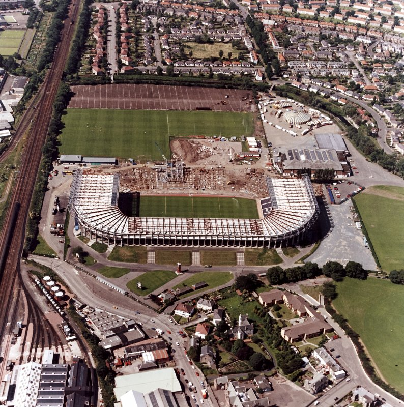 Aerial view of stadium under construction.