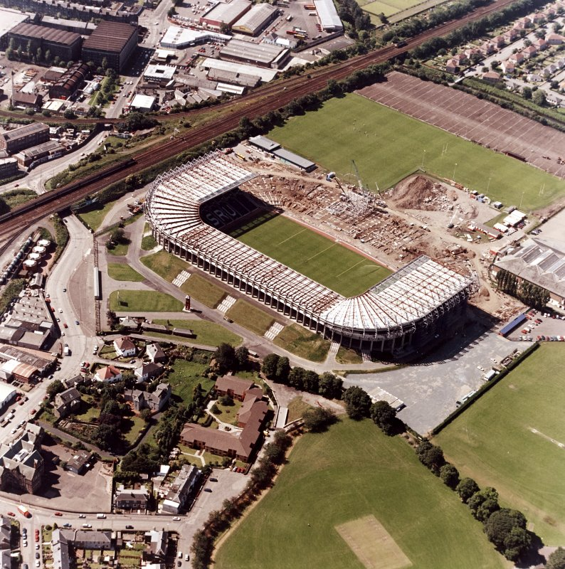 Aerial view of stadium during construction.