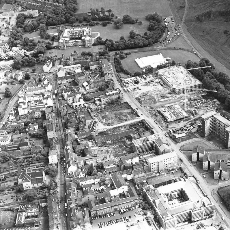 Oblique aerial view of Edinburgh centred on both 'Dynamic Earth' and the Scottish Parliament under construction, and a view of the Canongate, Holyrood Palace and Holyrood Abbey, taken from the WSW.