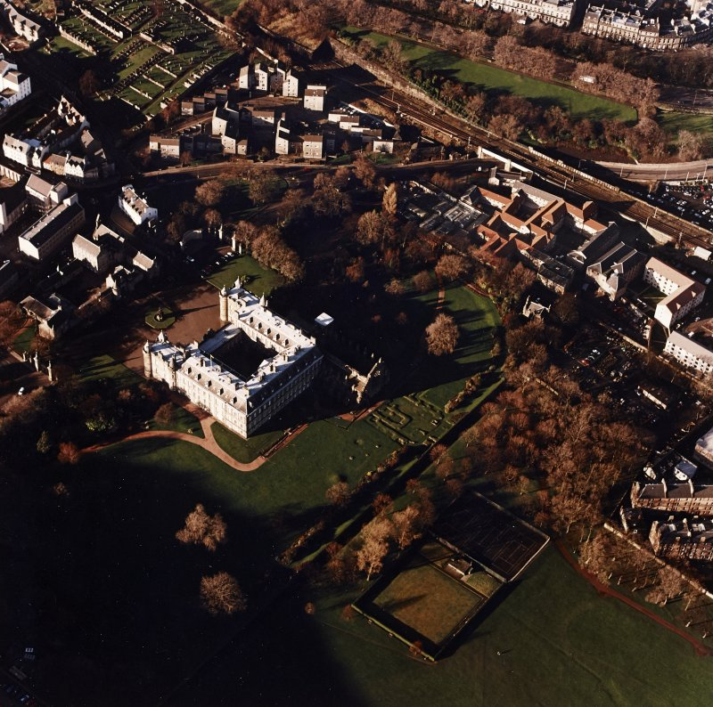 Oblique aerial view of Edinburgh centred on Holyrood Palace, taken from the SE.