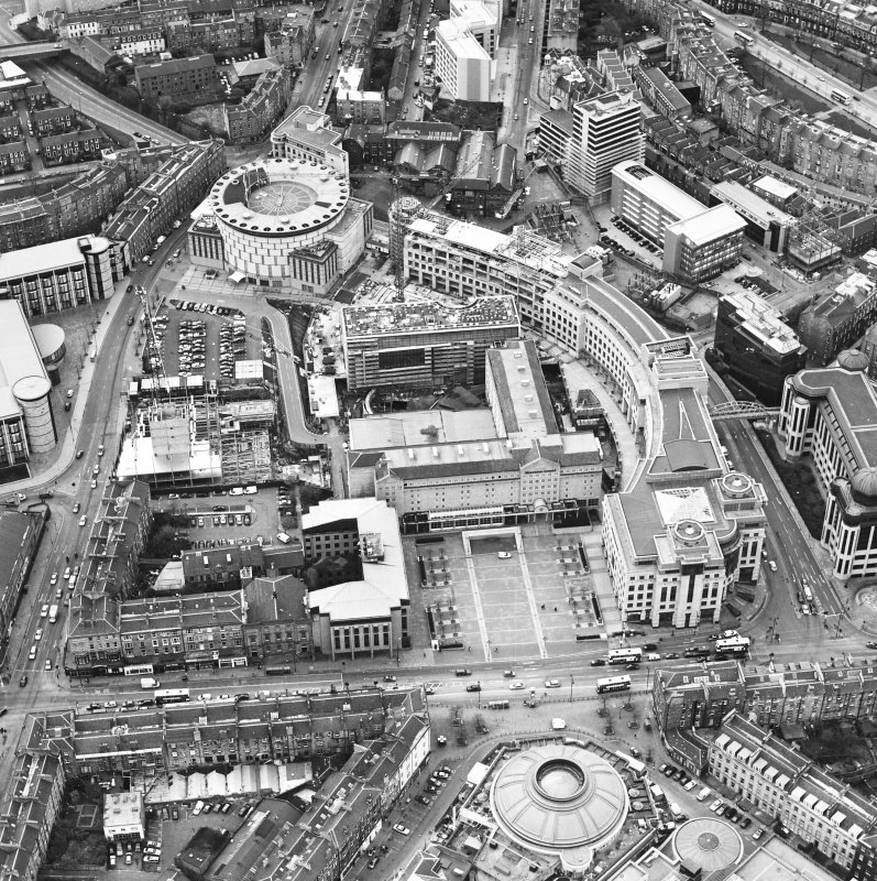 Oblique aerial view centred on the hotel, offices and conference centre, taken from the E.
