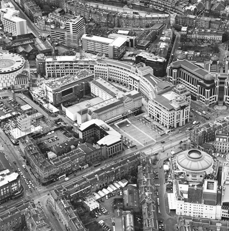 Oblique aerial view centred on the hotel, offices and conference centre, taken from the ESE.