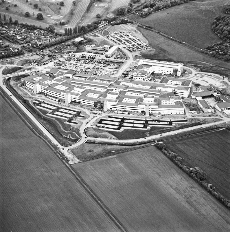 Oblique aerial view centred on the hospital, taken from the ENE.