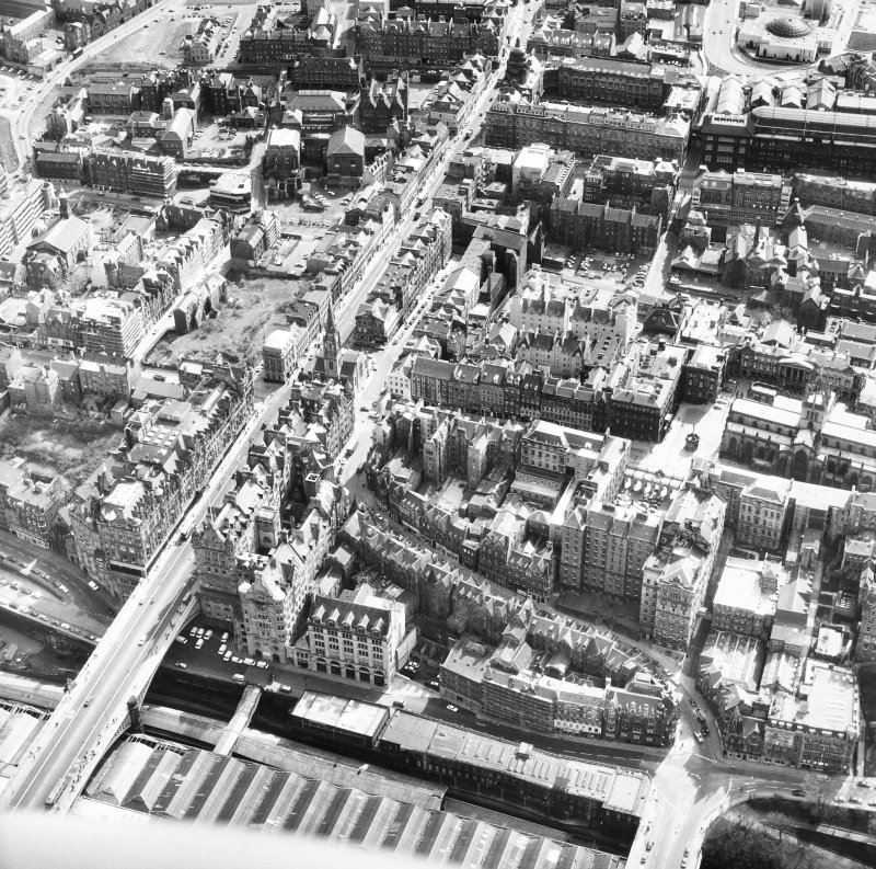 Aerial view showing High Street between North Bridge (on left of photo) and Lawnmarket with St Giles' Cathedral on far right of photo, City Chambers at centre right and Cockburn Street at bottom.