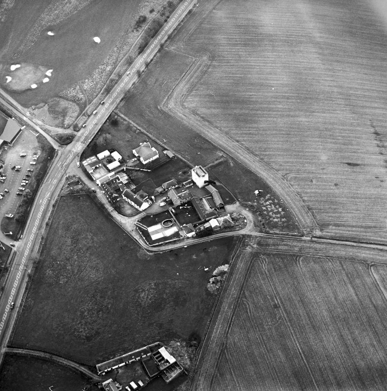 Oblique aerial view centred on the tower-house, taken from the ESE.