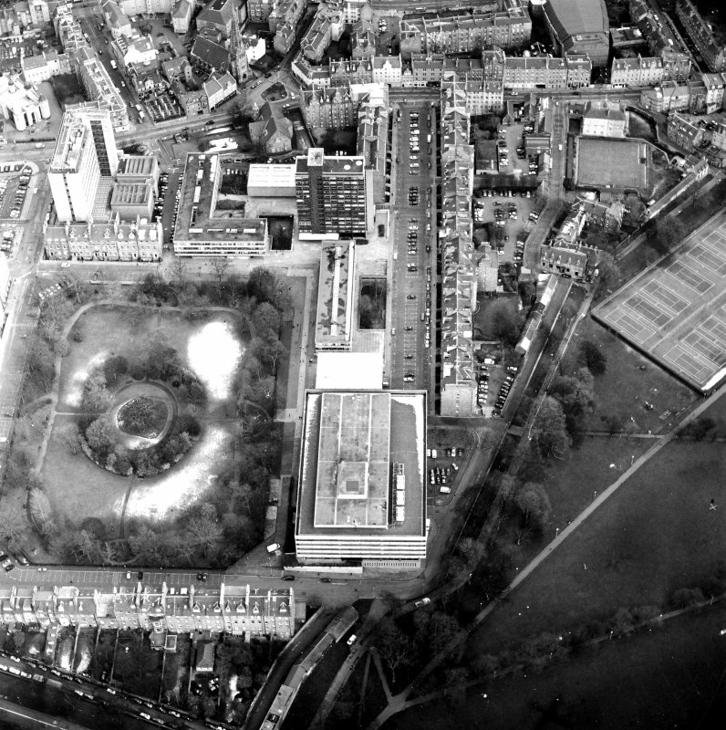 Oblique aerial view centred on the library with George Square and University buildings adjacent, taken from the WSW.