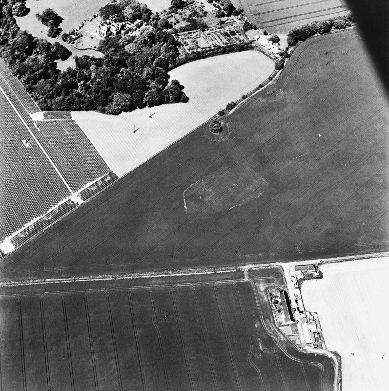 Oblique aerial view of Broomhouse taken from the SSE, centred on the cropmark of a quarry and a possible trackway, and showing Bowerhouse in the top left-hand corner of the photograph.
