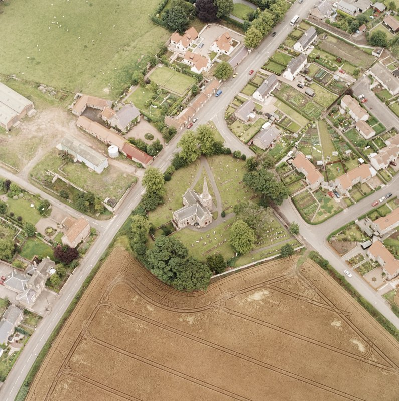 Oblique aerial photograph of East Saltoun centred on theParish Church and Graveyard, taken from the WNW.