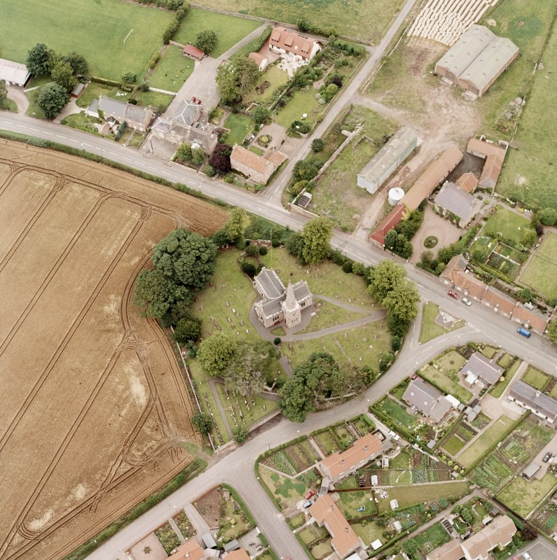 Oblique aerial photograph of East Saltoun centred on theParish Church and Graveyard, taken from the SW.