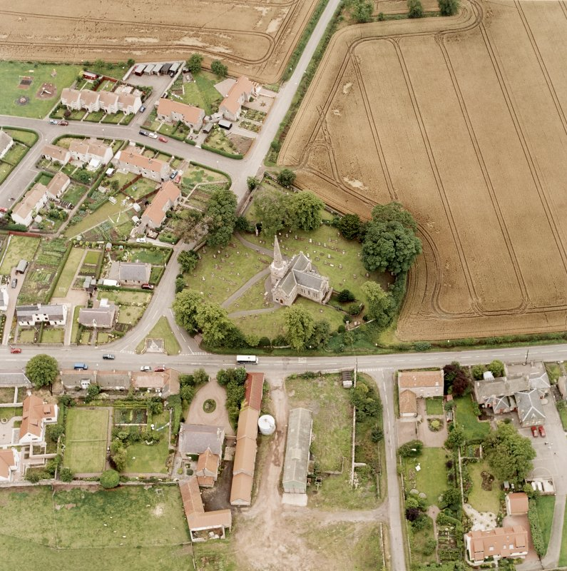 Oblique aerial photograph of East Saltoun centred on theParish Church and Graveyard, taken from the NE.