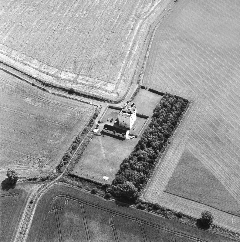 Obliqe aerial photograph centred on Falside Castle, taken from the NW.