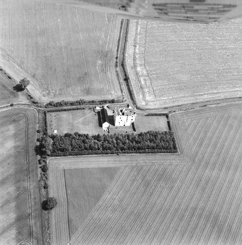 Oblique aerial photograph centred on Falside Castle, taken from the SW.