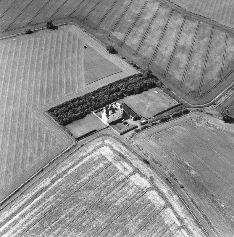 Oblique aerial photograph centred on Falside Castle, taken from the ENE.