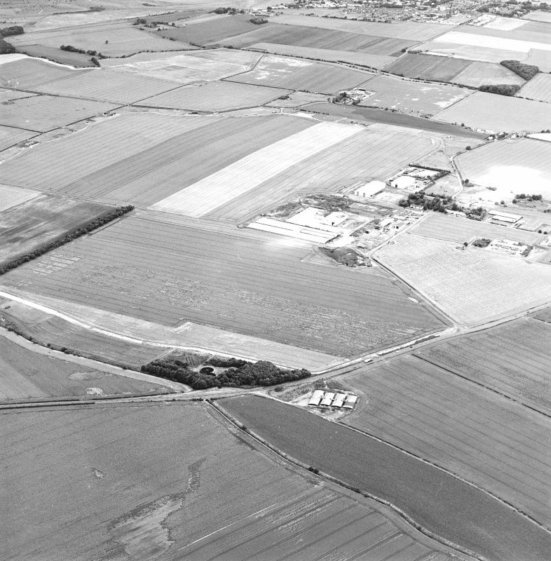Oblique aerial view of Drem Airfield centred on the remains of the airfield, taken from the SE.