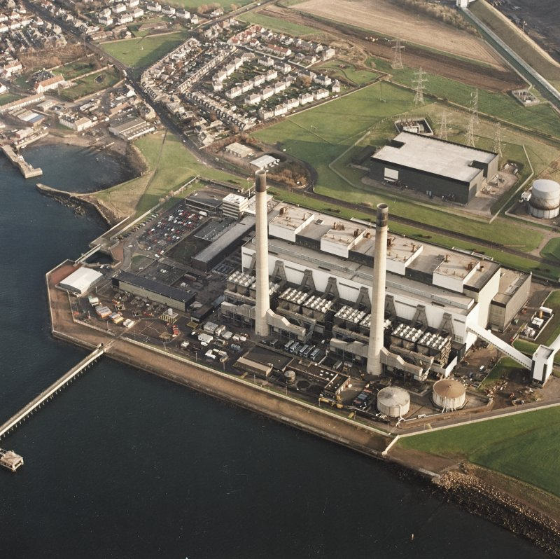 Oblique aerial view of the Cockenzie Generating Station centred on the power station with a harbour adjacent, taken from the N.