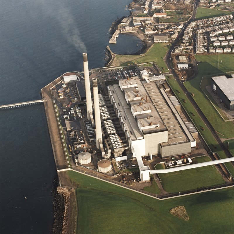 Oblique aerial view of the Cockenzie Generating Station centred on the power station with a harbour adjacent, taken from the W.