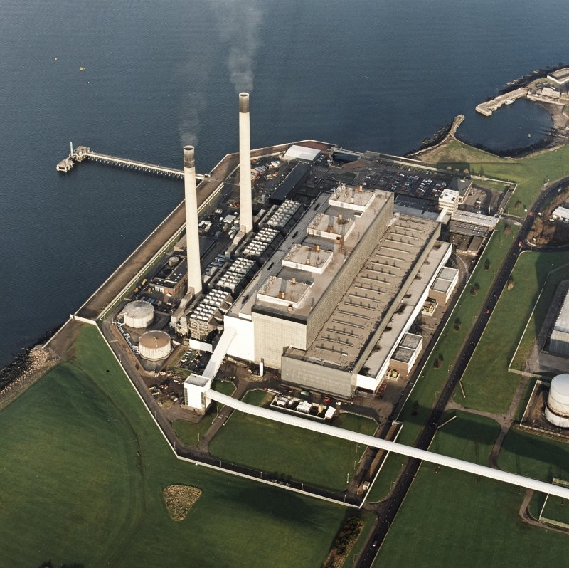 Oblique aerial view of the Cockenzie Generating Station centred on the powerstation with a harbour adjacent, taken from the S.