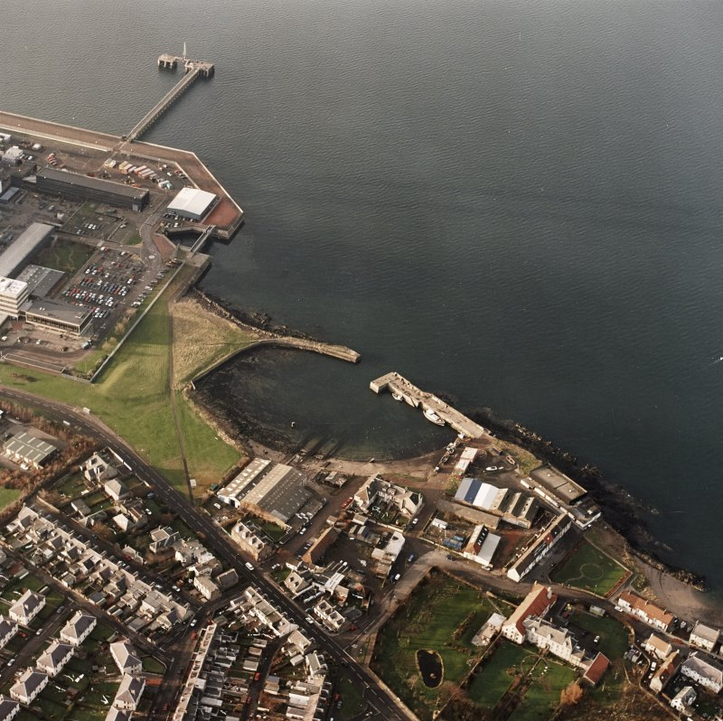 Oblique aerial view of the Cockenzie Harbour centred on the harbour with a power station adjacent, taken from the SE.