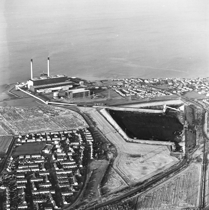 Oblique aerial view of the Cockenzie Coal Store centred on the coal store with an adjacent power station and harbour, taken from the S.