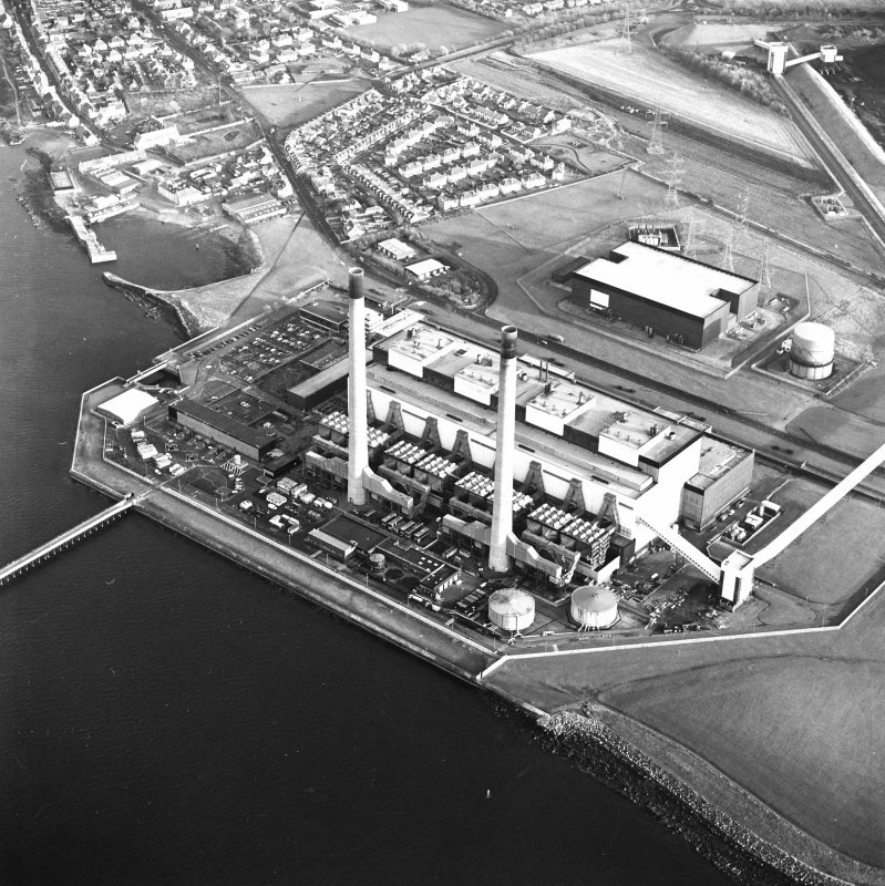 Oblique aerial view of the Cokenzie Generating Station centred on the power station with the  Harbour adjacent, taken from the NW.