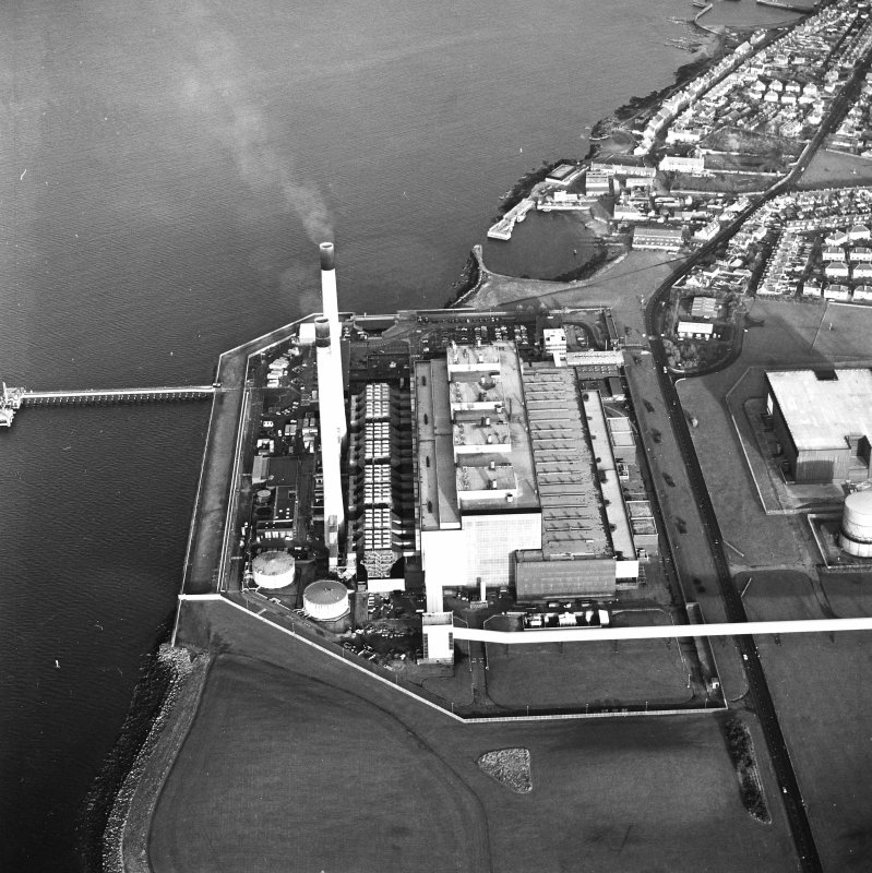 Oblique aerial view of the Cockenzie Generating Station centred on the power station with harbours adjacent, taken from the SE.