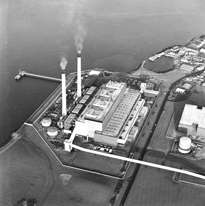 Oblique aerial view of the Cockenzie Generating Station centred on the power station with the  harbour adjacent, taken from the S.