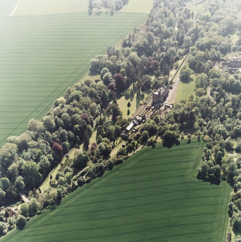 Oblique aerial view of Biel House, garden, gardener's cottage, coach-houses and bridge, taken from the NE.
