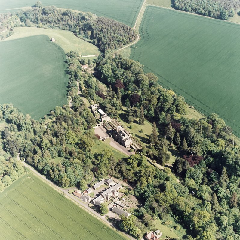 Oblique aerial view of Biel House, garden, gardener's cottage, bridge, dovecot, cottages and coach-houses, taken from the NW.