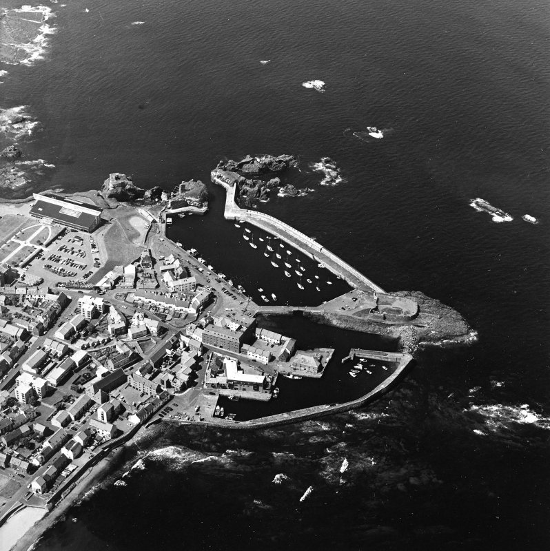 Oblique aerial view centred on the harbour with the remains of the battery adjacent, taken from the ESE.