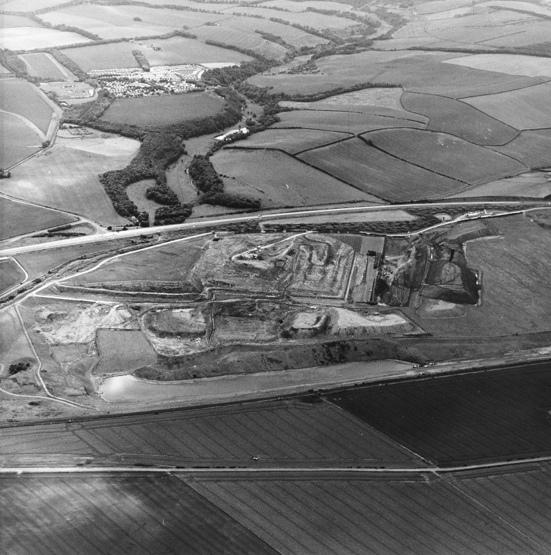 Oblique aerial view centred on the cement works and quarry, taken from the NE.