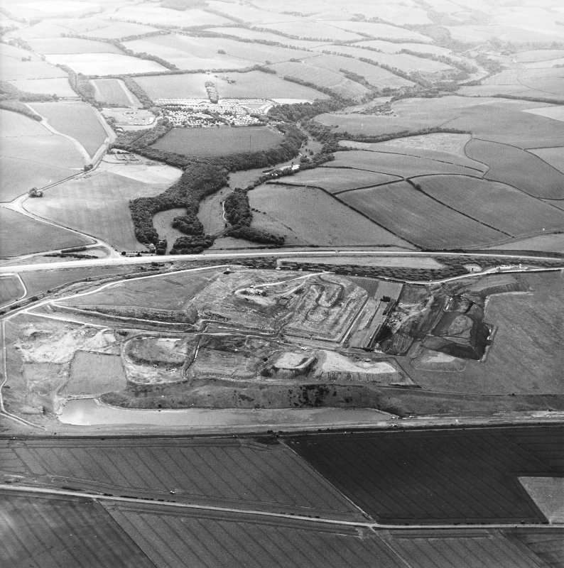 Oblique aerial view centred on the cement works and quarry, taken from the NNE.