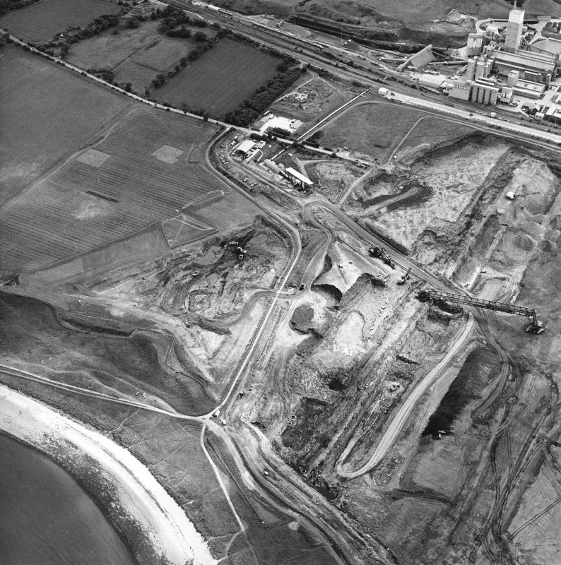 Oblique aerial view centred on the cement works and quarry with the trial excavations adjacent, taken from the NNW.